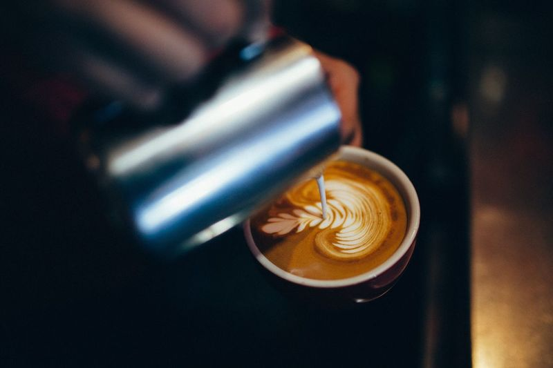 Cropped Image Of Hand Preparing Coffee