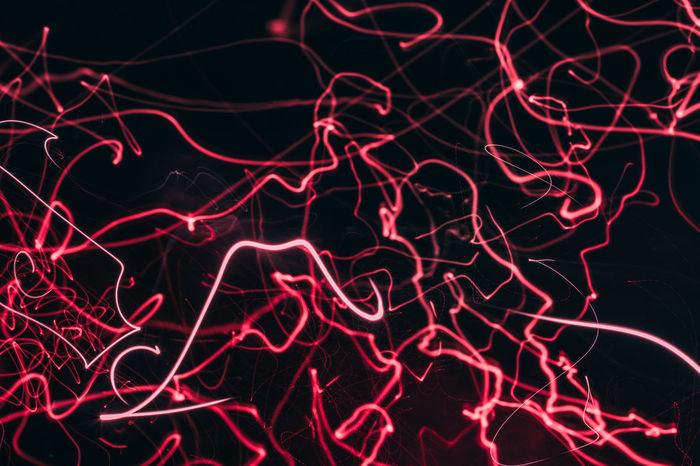 EyeEm AMPt_community Shootermag Neon Background Night Illuminated Red No People Complexity Pattern Long Exposure Backgrounds Full Frame Abstract Glowing Motion Light Painting Light Trail Light - Natural Phenomenon Black Background Light Electric Light Creativity Confusion Chaos