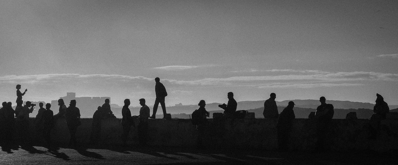 Wall of slow motion sundowns Essaouira Silhouette Silhouettes Of People Silhouette And Sky Outdoors Sky Sunset first eyeem photo