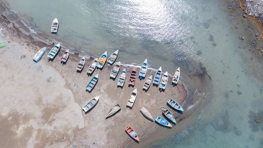 High Angle View Of Boats Moored At Beach