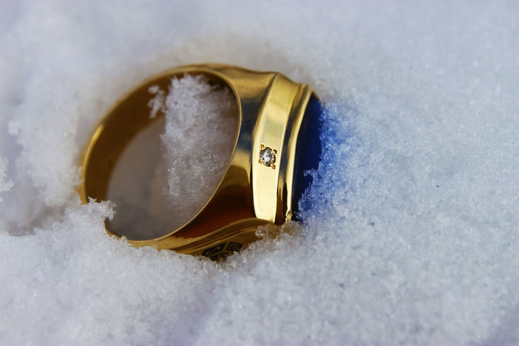 Close-up of ring in snow