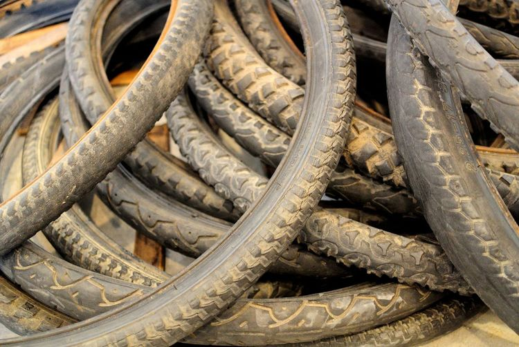 High angle view of abandoned bicycle tires