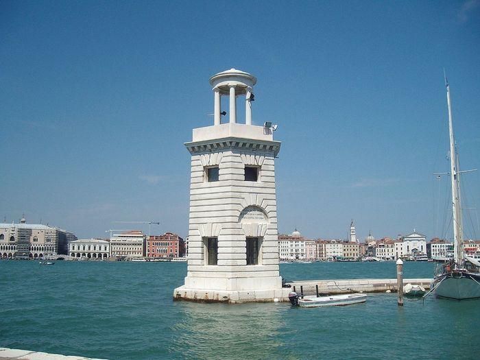 Lighthouse on grand canal against blue sky