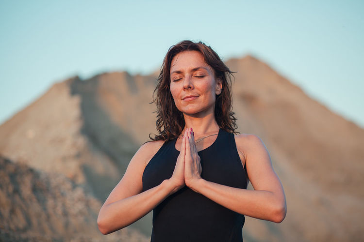 Mature Woman With Hands Clasped Doing Yoga