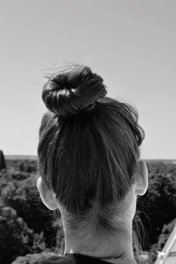 Rear view of woman with hair bun at art museum