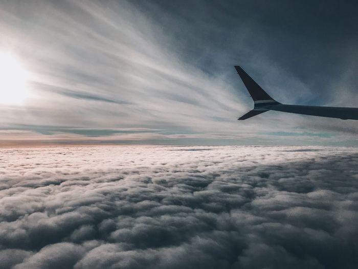 ShotOnIphone Over The Clouds From An Airplane Window Travel Flying In The Sky Flying Sky Cloud - Sky Flying Nature Beauty In Nature Tranquil Scene No People Environment Day Mid-air Tranquility Non-urban Scene Transportation Airplane Mode Of Transportation Scenics - Nature Cloudscape Nature Air Vehicle Sunset Aerial View Aircraft Wing Commercial Airplane Travel