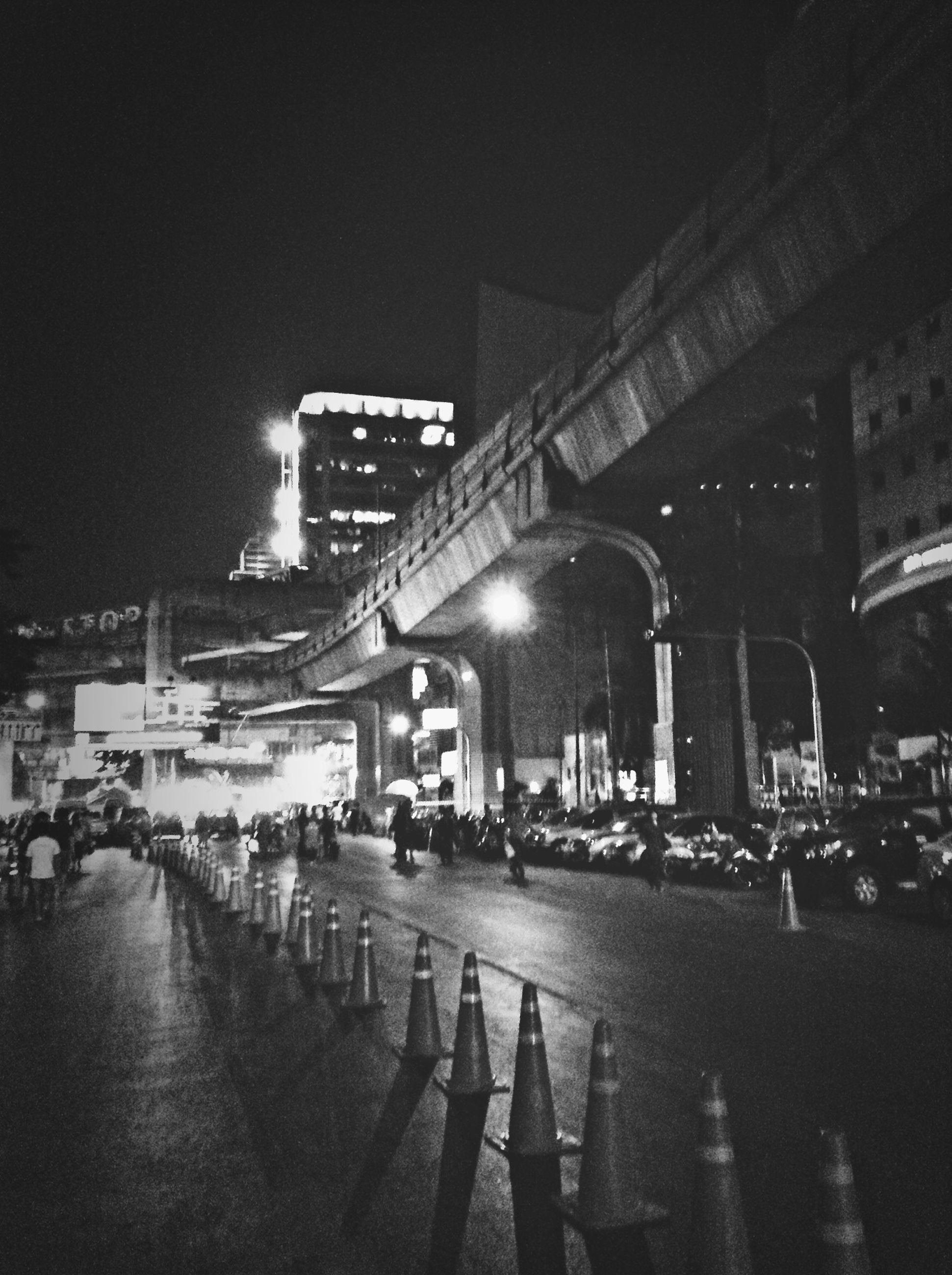 architecture, built structure, building exterior, illuminated, night, city, bridge - man made structure, transportation, connection, city life, street, street light, sky, river, large group of people, engineering, bridge, travel destinations, outdoors, incidental people