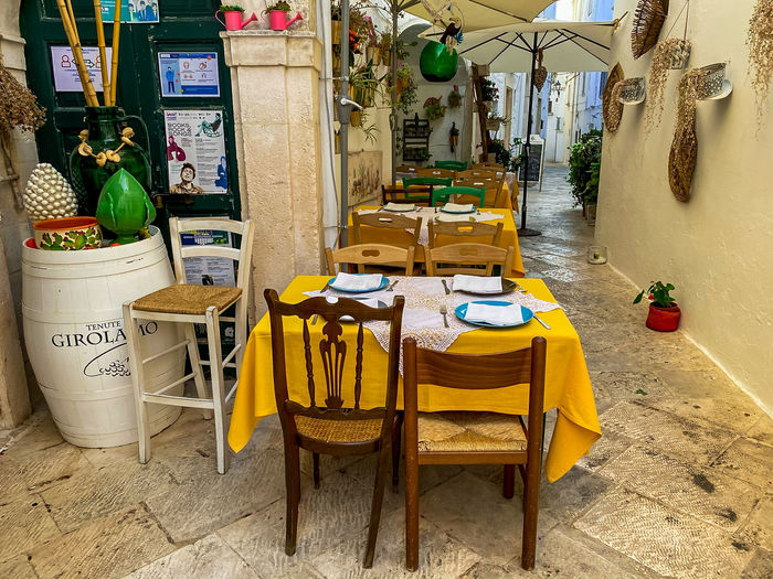 Empty chairs and table at market stall