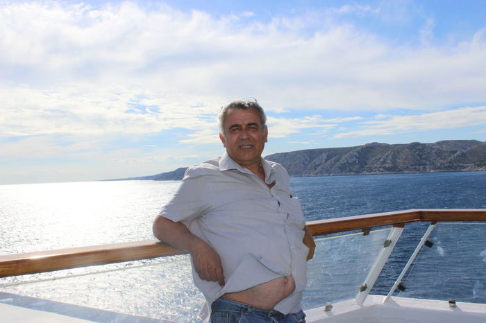 Adult Adults Only Boat Deck Croisiere Day Front View Lifestyles Looking At Camera Mature Adult Mature Men Men Méditerranée Nautical Vessel One Man Only One Mature Man Only One Person Only Men Outdoors People Portrait Sea Sky Smiling Vacations Water