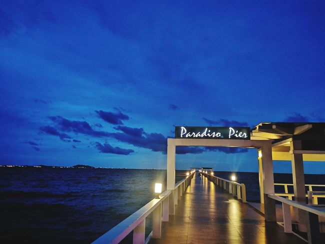 deep blue see EyeEmNewHere Neon Sea Water Illuminated Beach Blue Sunset Bridge - Man Made Structure Communication Dusk