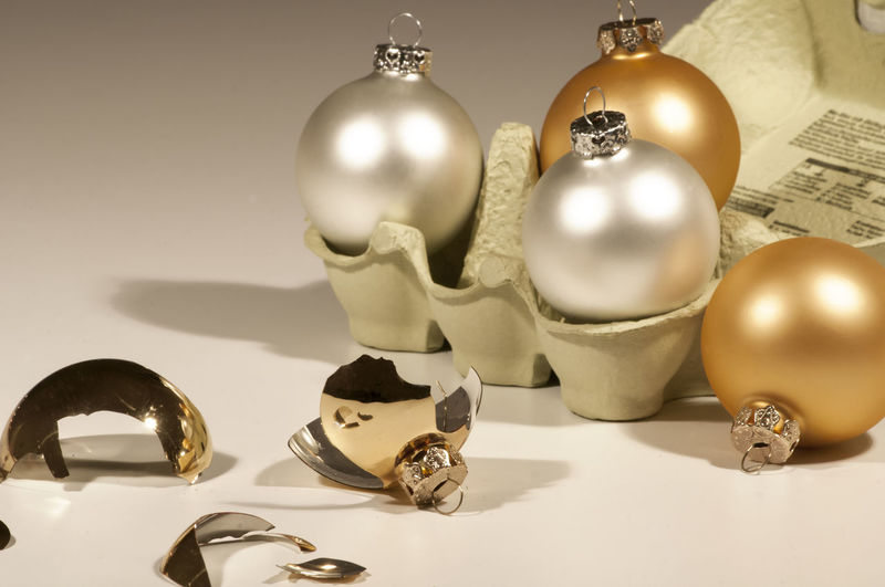 Close-Up Of Broken Baubles On White Background