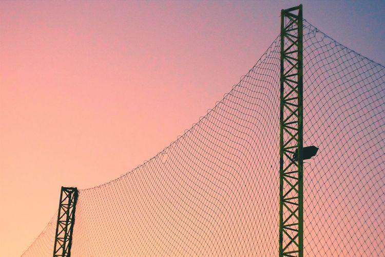 Low Angle View Of Fence Against Clear Sky