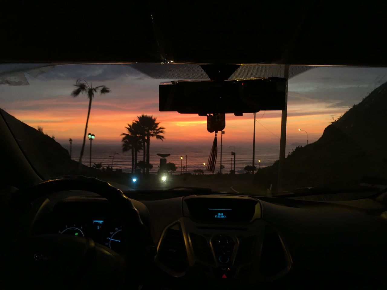 car, sunset, land vehicle, transportation, cloud - sky, sky, mode of transport, car interior, road, no people, nature, outdoors, technology, beauty in nature, tree, day