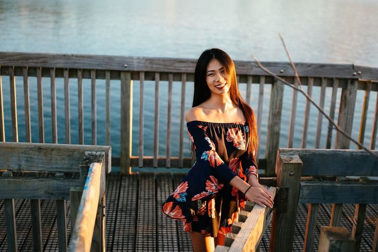 Railing Young Adult Smiling One Person Young Women Outdoors Leisure Activity Lifestyles Day Happiness Real People Full Length Women Portrait Architecture Nature Adult People Adults Only