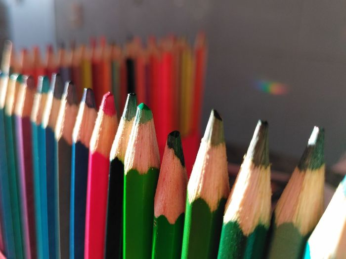 A row of colorful pencils