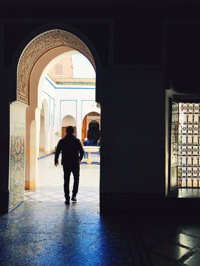Silhouette of man visiting historic building
