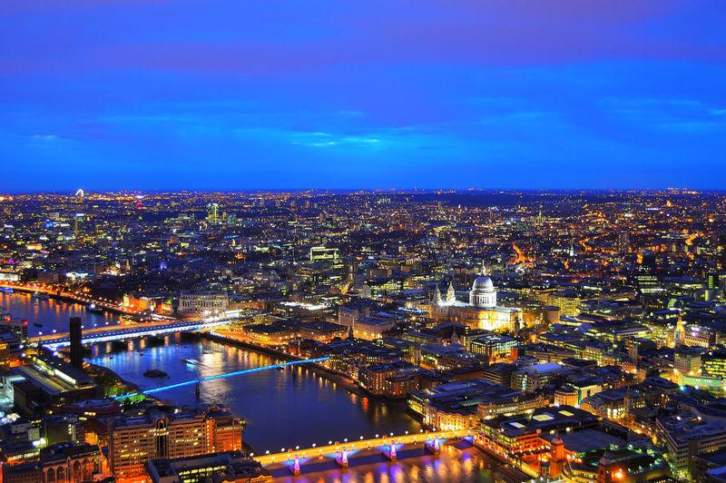 High angle view of illuminated cityscape at night
