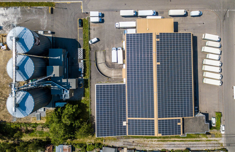 Directly above shot of solar panels on building roofs during sunny day