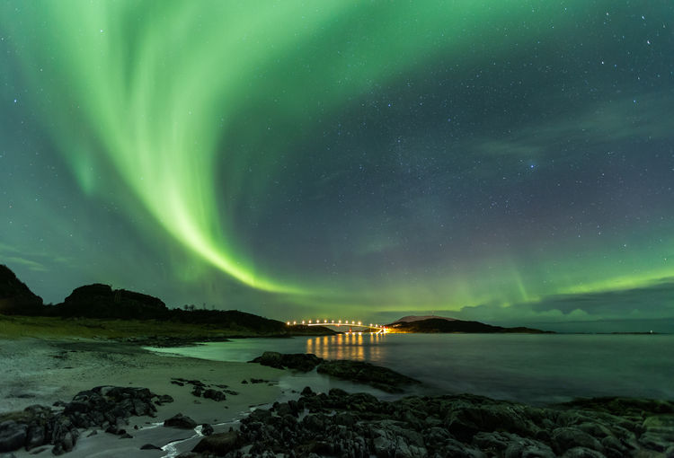 Aurora Aurora Borealis Green Sky Northern Lights Sommaroy Arctic Circle Astronomy Beauty In Nature Cold Temperature Green Color Natural Phenomenon Nature Night Outdoors Scenics Sea Sky Sommarøy Troms