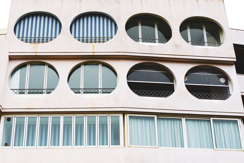 building front view detail Flat House Modern Man Made Structure Residential Building Landscape City Life Front View Close Up Residential District Facades Apartment Buildings Apartment Construction Cement Geometric Shape Shapes And Forms Structures Design Architecture Urban City White Background Blue Glass - Material Curtains Striped Round Window Building Exterior