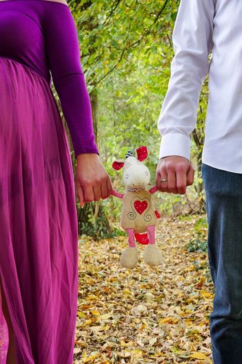 Midsection of couple holding toy