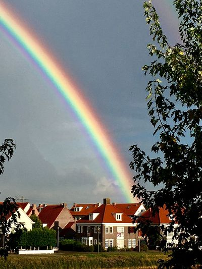 Rainbow Rainbow Building Exterior Beauty In Nature Sky Outdoors Nature