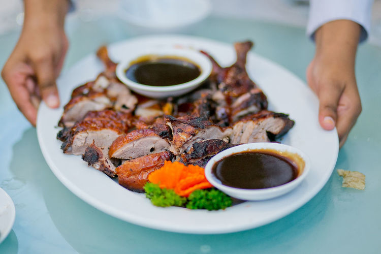 Roasted duck with bbq sauce BBQ Asian Food Close-up Day Duck Meat Focus On Foreground Food Freshness Human Body Part Human Hand Indoors  Meat Men One Person Oriental Food  Plate Ready-to-eat Real People Roasted Duck Sauce Serving Size