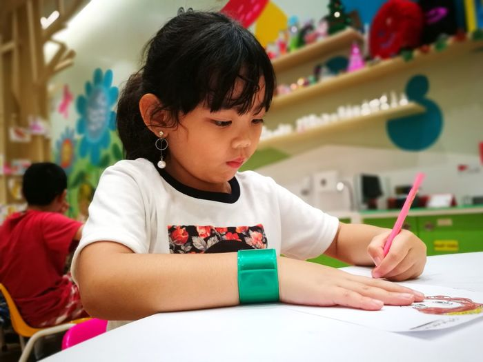 Child Learning Girls Paint Concentration