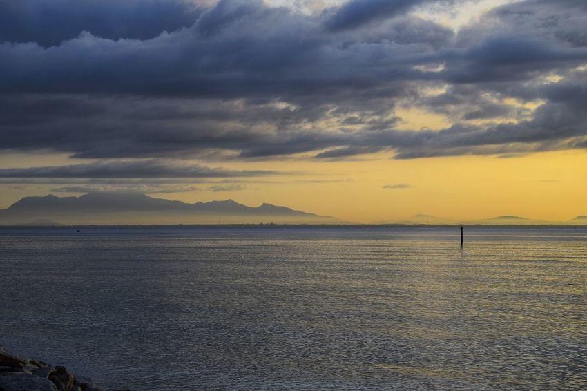 Sunrise over sea. Sunrise Water Sea Beach Silhouette Sky Landscape Horizon Over Water Cloud - Sky