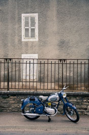 Vintage motorcycle parked against wall