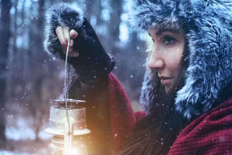 Woman Adult Adults Only Candlelight Close-up Cold Temperature Forest Nature Night Oil Lamp One Person Outdoors People Portrait Snow Snowflake Snowing Tree Warm Clothing Winter Young Adult