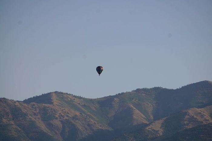 HotAirBallonFestival Viewpoint Viewfromdeck Huntsville Utah Ogdencanyon Hotairballoons Mountain Hot Air Balloon Flying Mid-air Beauty In Nature Clear Sky