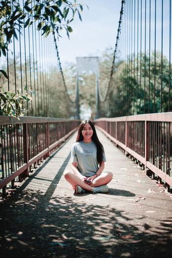 Portrait of woman on footbridge