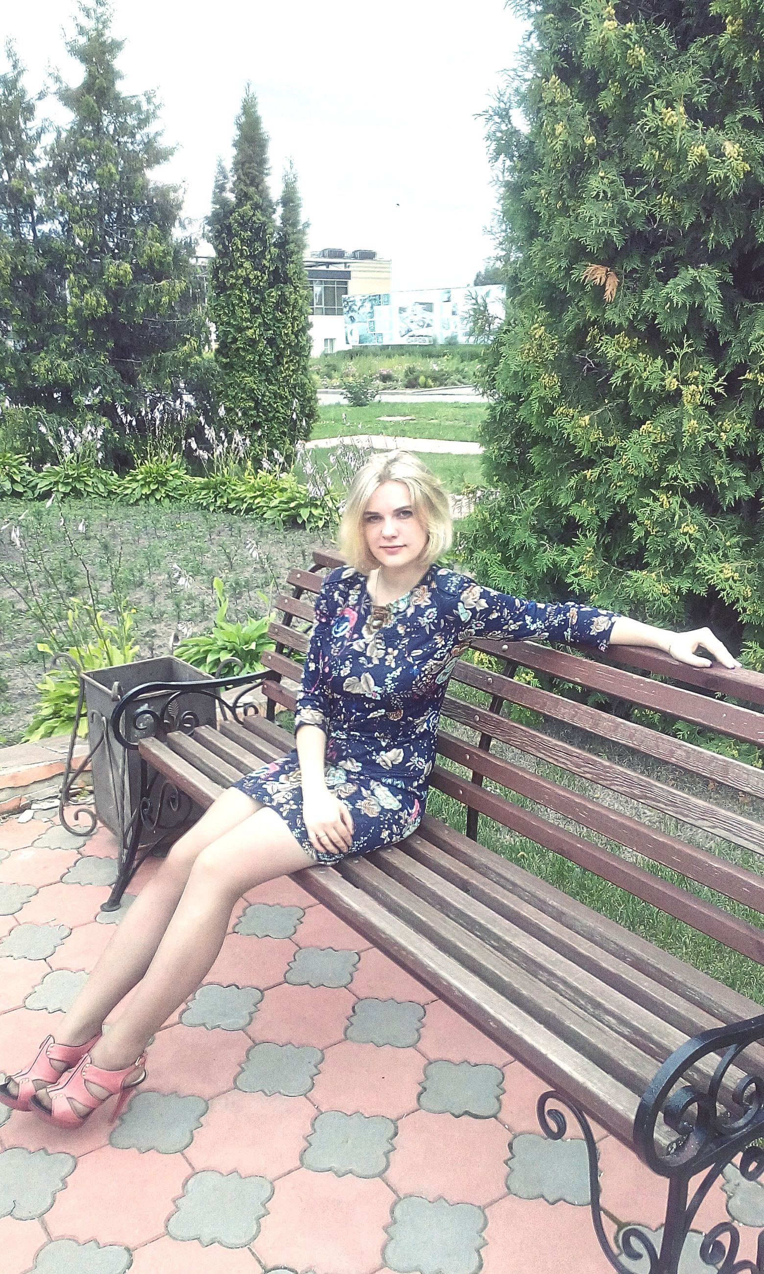 sitting, person, lifestyles, relaxation, casual clothing, leisure activity, full length, looking at camera, portrait, tree, childhood, young adult, park - man made space, young women, elementary age, smiling, bench, front view