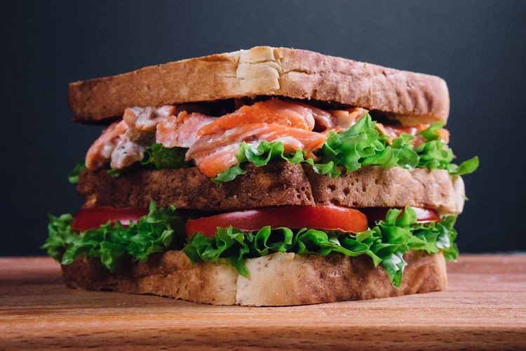 Sandwich Bread Bun Burger Close-up Cutting Board Day Food Food And Drink Freshness Indoors  Lettuce Meat Minced No People Ready-to-eat Salmon Sandwich Sandwich Tomato Unhealthy Eating