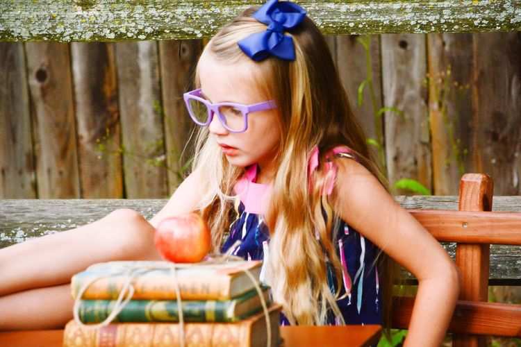 Blond Hair Childhood Day Outdoors One Person Child Girl Beauty Sitting Smart School Books Apple Pretendplay The Week On EyeEm EyeEmNewHere