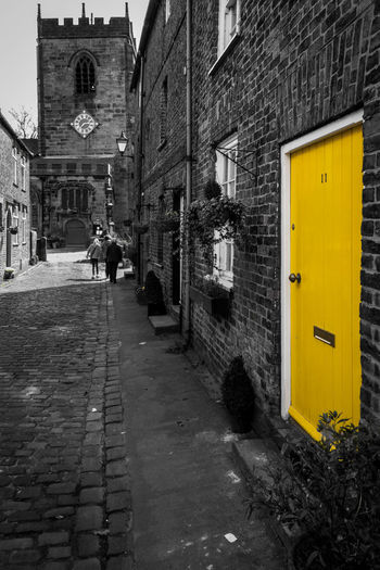 Walking to church Architecture Building Building Exterior Built Structure City City Life City Street Day Diminishing Perspective Outdoors Residential Building Residential Structure The Way Forward Yellow