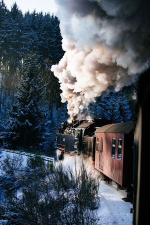 EyeEm Best Shots Tadaa Community Brocken Brockenbahn Built Structure Cold Temperature Day Emitting Germany Harz Mountain Nature No People Outdoors Sky Smoke - Physical Structure Snow Steam Train Tree Winter