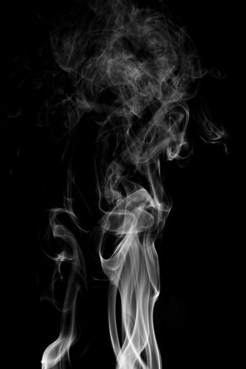Abstract Black Background Burning Changing Form Close-up Copy Space Fumes Heat - Temperature Incense Indoors  Motion Moving Up Nature No People Pattern Sign Smoke - Physical Structure Smoking Issues Studio Shot Swirl