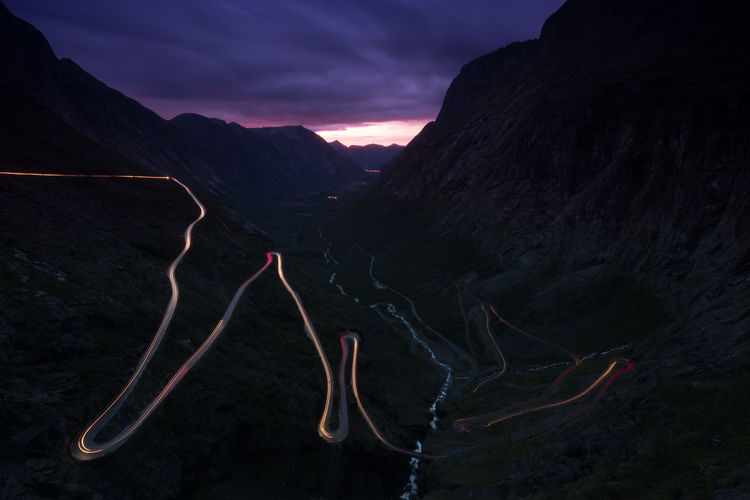 High angle view of light trail on mountain road at dusk