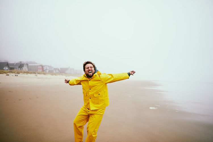 Happy Man At Beach Against Sky