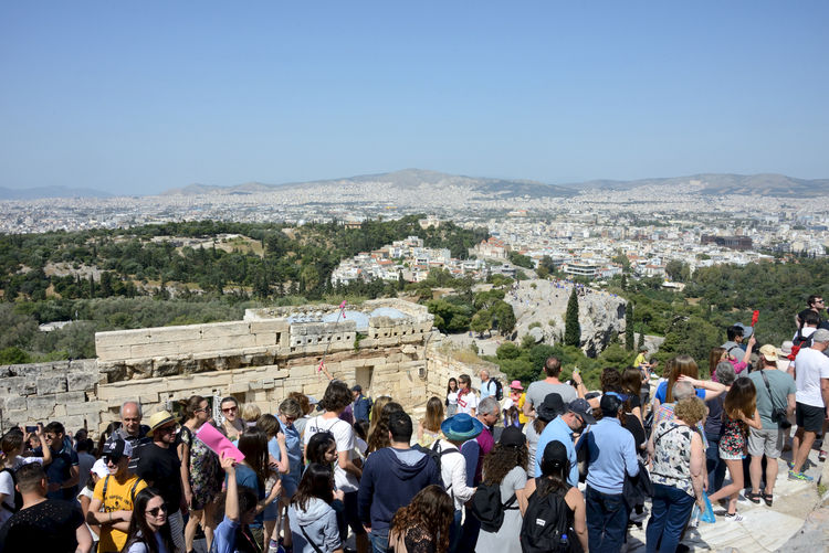crowd in the Acropolis among the ruins and cityscape of Athens Crowd Group Of People Large Group Of People Architecture Real People Travel Destinations Sky Travel Men Built Structure Nature Building Exterior Day Leisure Activity Mountain Tourism Women History Lifestyles Outdoors Athens, Greece Acropolis, Athens Archeological Site Cityscape Urban Skyline Archeology Tourism Destination Famous Place City Summertime Landmarks Highlights Greek Ruins