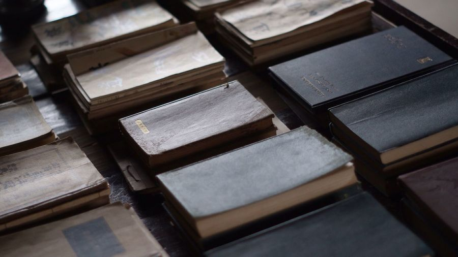 High Angle View Of Old Books Arranged On Table