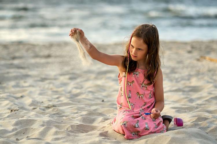 Full length of girl on beach