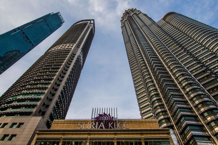 Architecture Built Structure Building Exterior City Building Low Angle View Skyscraper Office Building Exterior Sky Tall - High Cloud - Sky Travel Destinations Nature Day Office Tower Modern No People Outdoors Financial District  Malaysia Malay Twin Towers Pitronas Life Is Beautiful