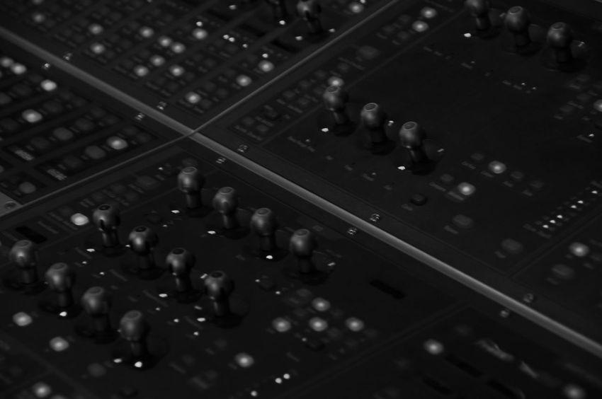 Mixing Desk in a Recording Studio Audio Audio Equipment Dark Sound Sound Desk Abstract Arts Culture And Entertainment Audio Electronics Audio Equipment Close-up Control Control Panel Creativity Indoors  Knob Knobs Music Music Studio  Musical Equipment Selective Focus Sound Mixer Sound Recording Equipment Studio Studio Shot Technology