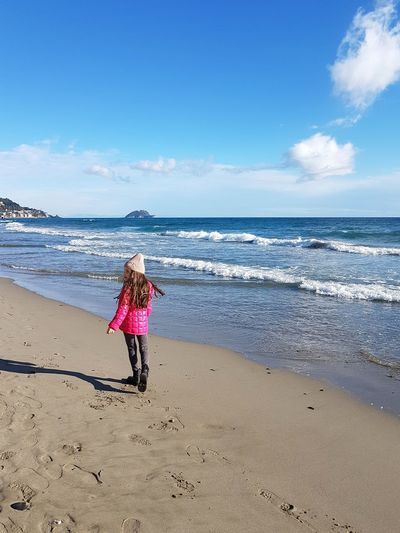 girl walking on the beach in winter Girl One Girl Only On The Beach Relaxing Moments Winter Sea Winter Beach Blue Sky Sunny Day At Beach Girl At Beach Winter Vacation Funny Moments Wintertime Travel Destinations Travel Winter Travel Bright Colors Shades Of Winter