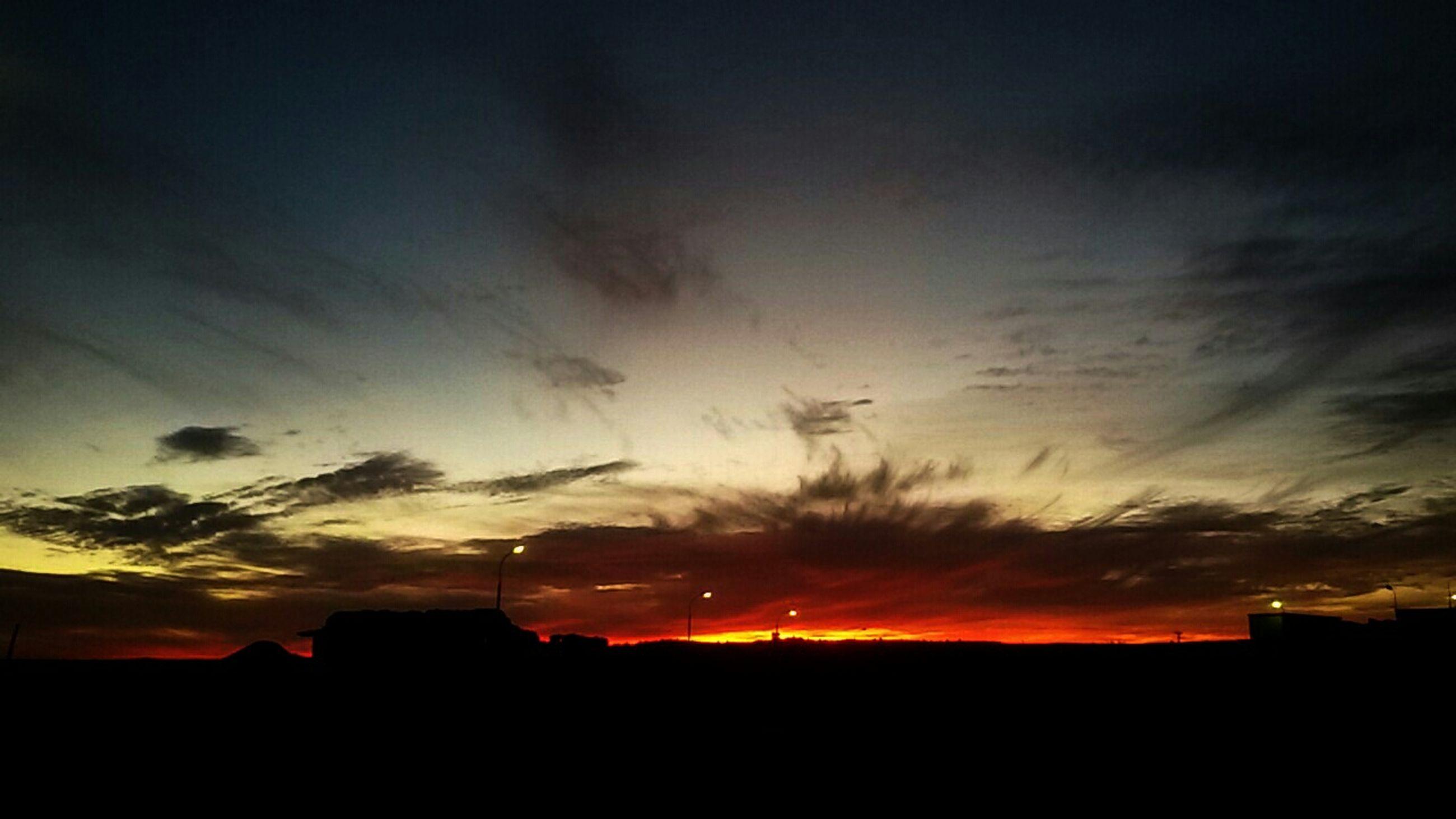 sunset, silhouette, sky, building exterior, built structure, architecture, orange color, cloud - sky, beauty in nature, scenics, sun, nature, cloud, dark, dramatic sky, house, outdoors, dusk, tranquil scene, moody sky