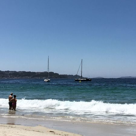 Sea Water Real People Clear Sky Nature Full Length Beach Outdoors Leisure Activity Scenics Day Tranquil Scene Men Beauty In Nature Horizon Over Water Rear View Standing Lifestyles Sand Two People Bueu Pontevedra Galicia SPAIN