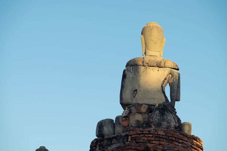 Buddha back with blue sky background. Architecture Buddha Buddha Head Buddha Image Buddha Statue Buddha Statues Clear Sky Day No People Outdoors Religion Sculpture Sky Statue